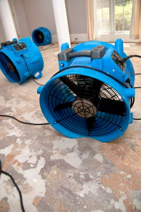 Twins Water Restoration's drying fans in water damaged house.